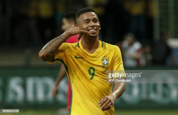 Brazil's Gabriel Jesus celebrates after scoring against Chile during their 2018 World Cup football qualifier match in Sao Paulo Brazil on October 10...