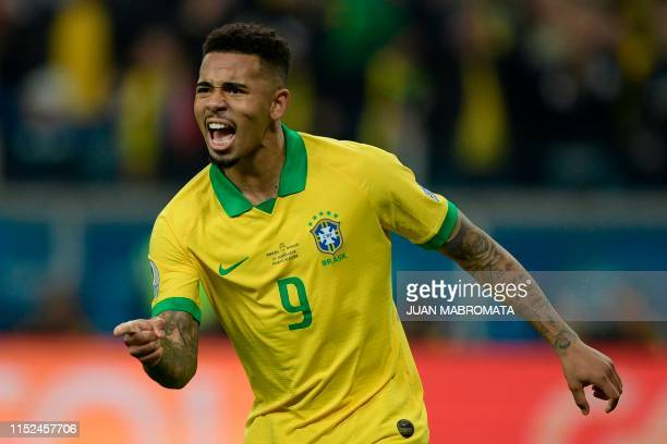 Brazil's Gabriel Jesus celebrates after scoring his penalty to defeat Paraguay in the penalty shootout after tying 00 during their Copa America...