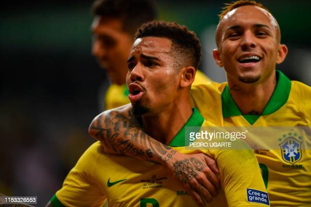 Brazil's Gabriel Jesus celebrates with teammate Everton after scoring against Argentina during their Copa America football tournament semi-final...