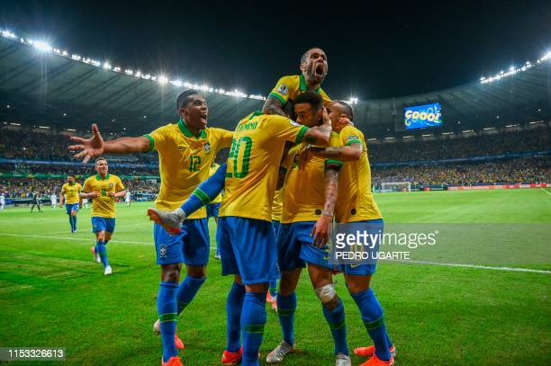 Brazil's Gabriel Jesus celebrates with teammates after scoring against Argentina during their Copa America football tournament semifinal match at the...