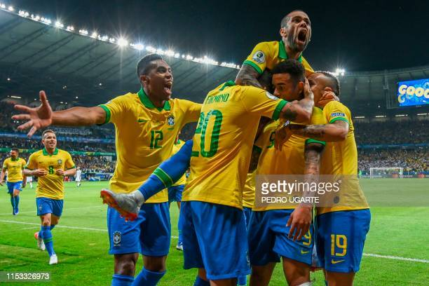 TOPSHOT Brazil's Gabriel Jesus celebrates with teammates after scoring against Argentina during their Copa America football tournament semifinal...