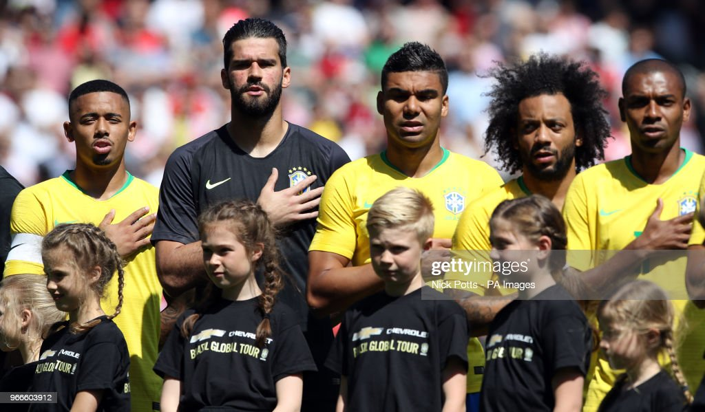 Brazil's (from left to right) Gabriel Jesus, goalkeeper Alisson, Casemiro, Marcelo and Fernandinho sing the national anthem before the International Friendly match at Anfield, Liverpool.