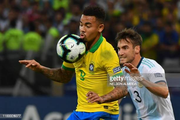 Brazil's Gabriel Jesus is marked by Argentina's Nicolas Tagliafico during their Copa America football tournament semi-final match at the Mineirao...