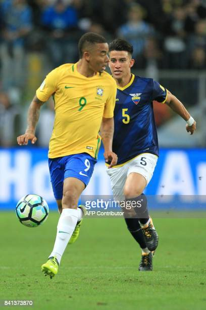 Brazil's Gabriel Jesus is marked by Ecuador's Fernando Gaibor during their 2018 World Cup qualifier football match in Porto Alegre Brazil on August...