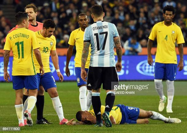 Brazil's Gabriel Jesus reacts in pain following a collision with Argentina's Nicolas Otamendi during the friendly international football match...