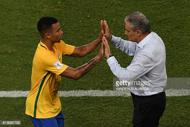Brazil's Gabriel Jesus shakes hands with Brazilian coach Tite during their Russia 2018 World Cup qualifier football match Bolivia in Natal Brazil on...