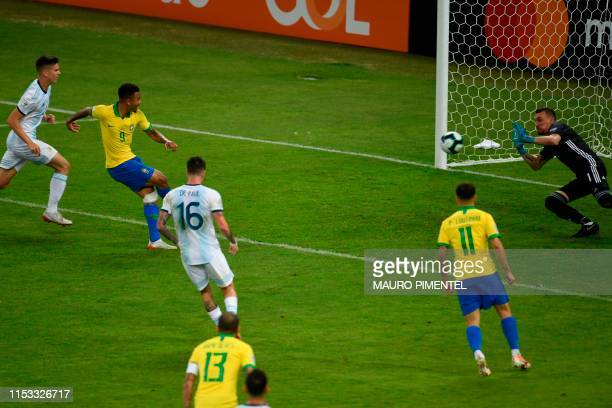 Brazil's Gabriel Jesus strikes the ball to score past Argentina's goalkeeper Franco Armani during their Copa America football tournament semifinal...