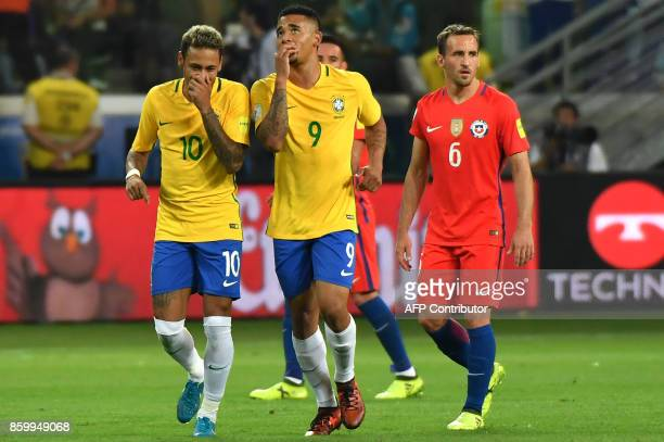 Brazil's Gabriel Jesus talks with teammate Neymar after scoring against Chile during their 2018 World Cup football qualifier match in Sao Paulo...