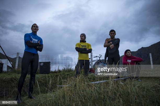 Brazil's Gil Fereira gets ready before his early morning session during the Lofoten Masters 2017 the world's most northerly surf competition in...