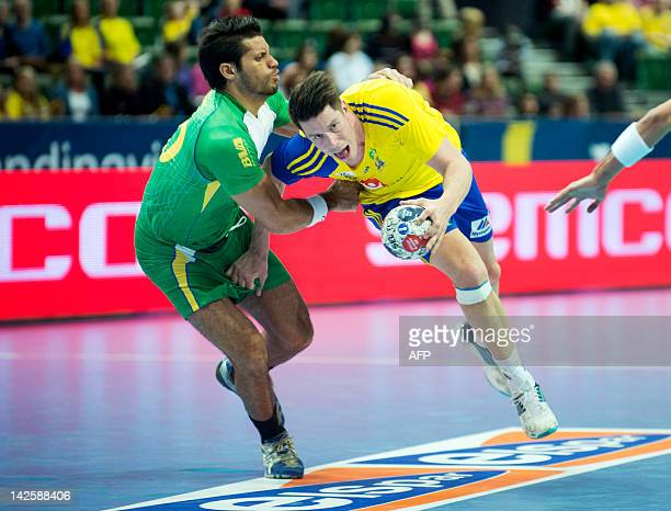 Brazil's Gil Vicente Pire vies for the ball with Sweden's Kim Andersson during their men's handball Olympic qualifying match in Gothenburg on April 6...