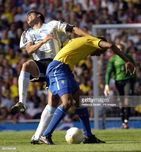 Brazil's Gilberto Silva fouls Argentina captain Juan Roman Riquelme during the International Friendly match at Emirates Stadium London