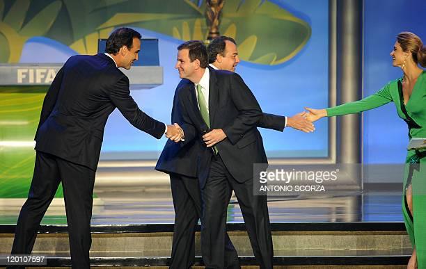 Brazil's Globo Rede TV presenter Tadeu Schmidt and Rio de Janeiro's Mayor Eduardo Paes, and Rio de Janeiro's governor Sergio Cabral and Brazilian...