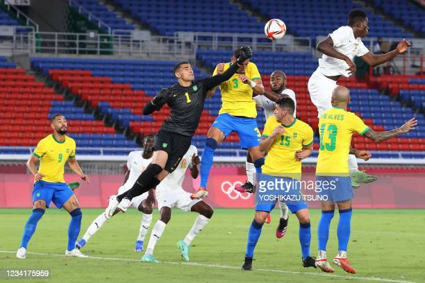 Brazil's goalkeeper Aderbar Santos punches the ball as he makes a save during the Tokyo 2020 Olympic Games men's group D first round football match...