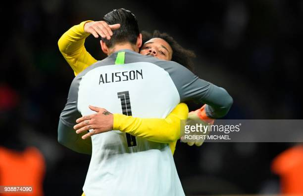 Brazil's goalkeeper Alisson and Brazil's defender Marcelo celebrate after their international friendly football match between Germany and Brazil in...