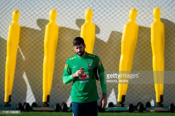 Brazil's goalkeeper Alisson arrives to a training session at Porto's training ground in Olival in Vila Nova de Gaia on March 20 2019 ahead of an...