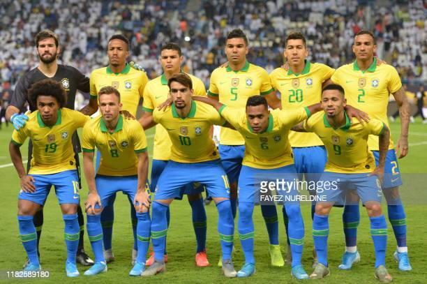 Brazil's goalkeeper Alisson Becker, defender Eder Militao, defender Thiago Silva, midfielder Casemiro, forward Roberto Firmino, defender Danilo,...