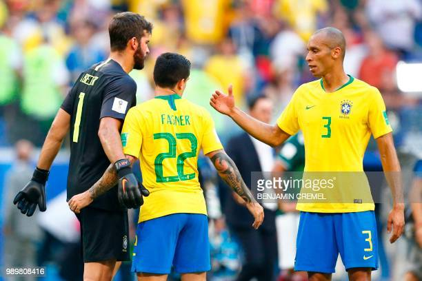 Brazil's goalkeeper Alisson Brazil's defender Fagner and Brazil's defender Miranda celebrate at the end of the Russia 2018 World Cup round of 16...