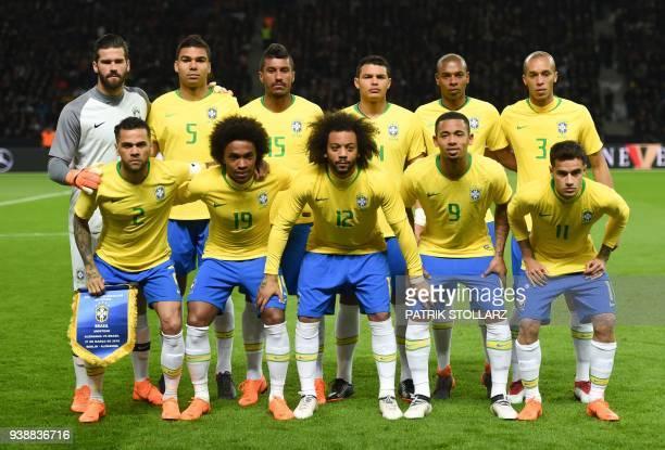 Brazil's goalkeeper Alisson Brazil's midfielder Casemiro Brazil's midfielder Paulinho Brazil's defender Thiago Silva Brazil's midfielder Fernandinho...
