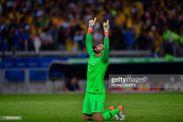 Brazil's goalkeeper Alisson celebrates after teammate Roberto Firmino scores the team's second goal against Argentina during their Copa America...