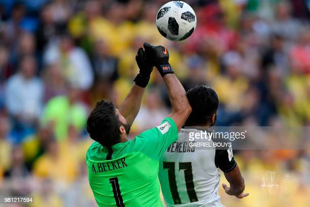 Brazil's goalkeeper Alisson clears the ball beside Costa Rica's forward Johan Venegas during the Russia 2018 World Cup Group E football match between...