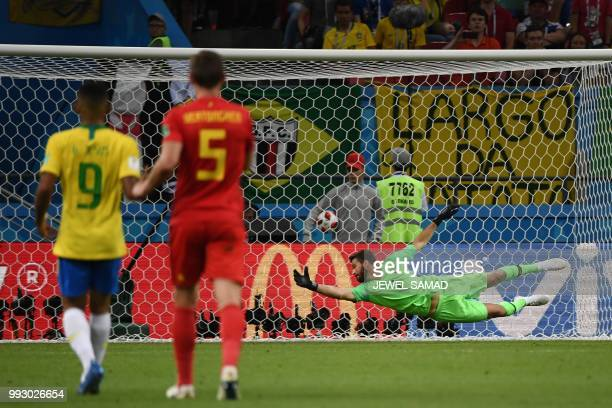 Brazil's goalkeeper Alisson concedes a second goal during the Russia 2018 World Cup quarterfinal football match between Brazil and Belgium at the...