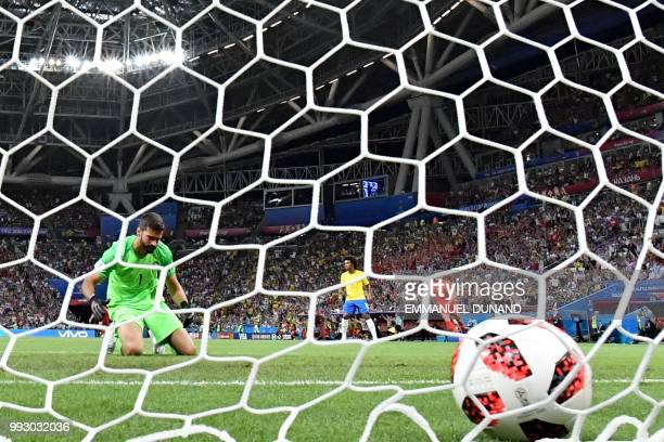 Brazil's goalkeeper Alisson concedes his team's second goal during the Russia 2018 World Cup quarterfinal football match between Brazil and Belgium...