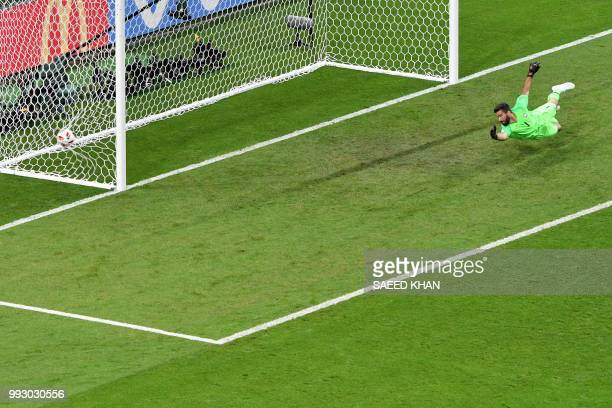 TOPSHOT Brazil's goalkeeper Alisson concedes the second goal during the Russia 2018 World Cup quarterfinal football match between Brazil and Belgium...