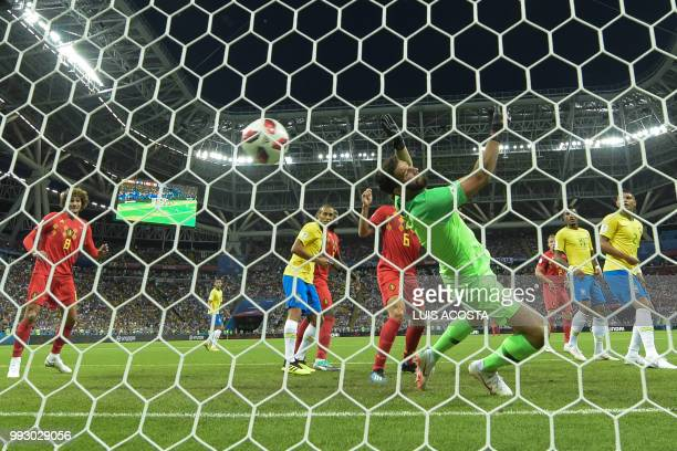 Brazil's goalkeeper Alisson dives and takes the opening goal during the Russia 2018 World Cup quarterfinal football match between Brazil and Belgium...