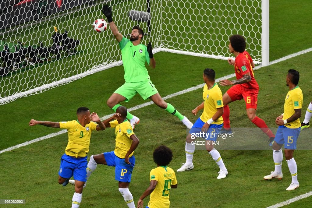 TOPSHOT - Brazil's goalkeeper Alisson (TOP) fails to stop an own-goal by Brazil's midfielder Fernandinho (2L) during the Russia 2018 World Cup quarter-final football match between Brazil and Belgium at the Kazan Arena in Kazan on July 6, 2018. (Photo by SAEED KHAN / AFP) / RESTRICTED
