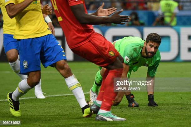 Brazil's goalkeeper Alisson gets back to his feet during the Russia 2018 World Cup quarterfinal football match between Brazil and Belgium at the...