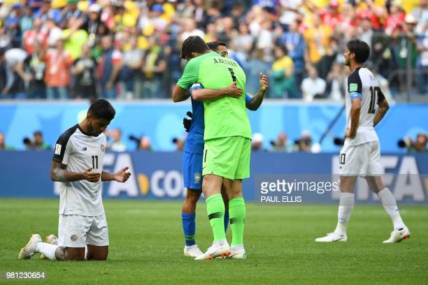 Brazil's goalkeeper Alisson hugs Brazil's forward Philippe Coutinho following their win during the Russia 2018 World Cup Group E football match...