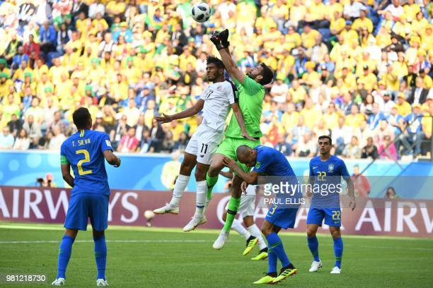 Brazil's goalkeeper Alisson jumps the punch the ball ahead of Costa Rica's forward Johan Venegas during the Russia 2018 World Cup Group E football...