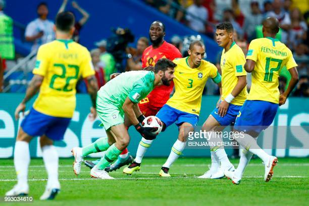 Brazil's goalkeeper Alisson makes a save during the Russia 2018 World Cup quarterfinal football match between Brazil and Belgium at the Kazan Arena...