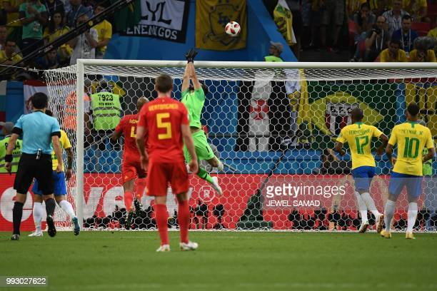 Brazil's goalkeeper Alisson pushes the ball over the bar during the Russia 2018 World Cup quarterfinal football match between Brazil and Belgium at...