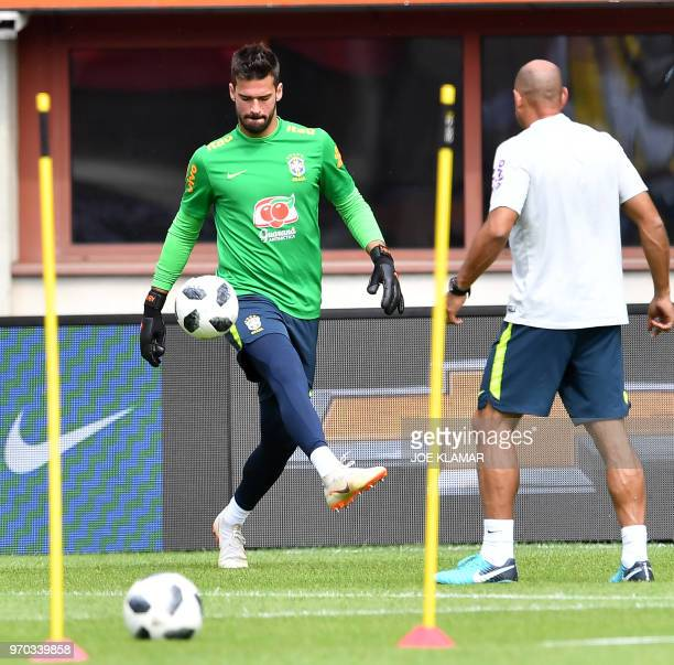 Brazil's goalkeeper Alisson Ramses Becker attends Brazil's training session at Ernst Happel stadium in Vienna Austria on June 9 on the eve of their...