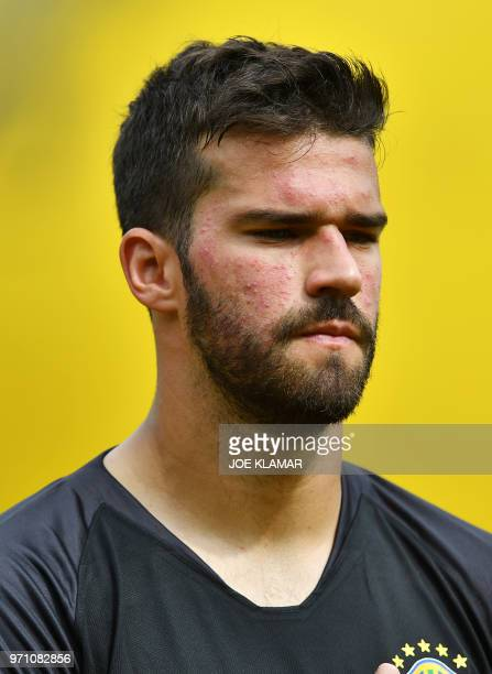 Brazil's goalkeeper Alisson Ramses Becker listens to his national anthem prior the friendly match between Austria and Brazil at Ernst Happel stadium...