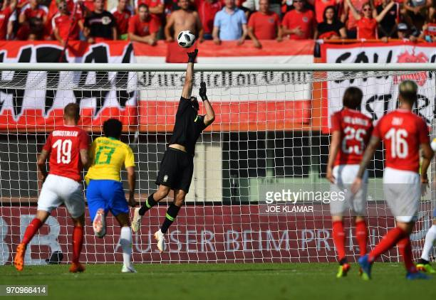 Brazil's goalkeeper Alisson Ramses Becker makes a save during the international friendly footbal match Austria vs Brazil in Vienna on June 10 2018