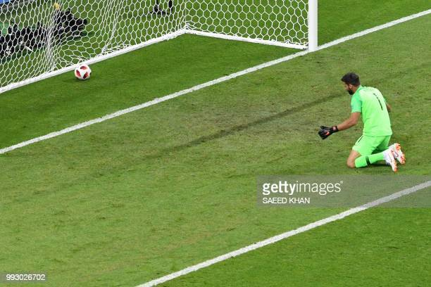 Brazil's goalkeeper Alisson reacts after concedeing the second goal during the Russia 2018 World Cup quarterfinal football match between Brazil and...