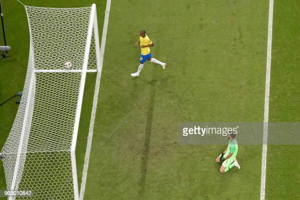 Brazil's goalkeeper Alisson reacts after conceding a second goal during the Russia 2018 World Cup quarterfinal football match between Brazil and...