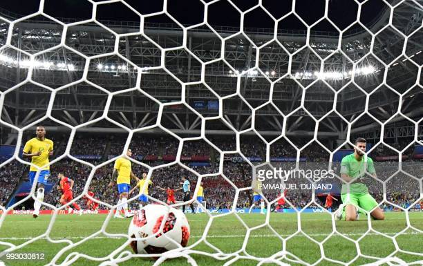Brazil's goalkeeper Alisson reacts after conceding his team's second goal during the Russia 2018 World Cup quarterfinal football match between Brazil...