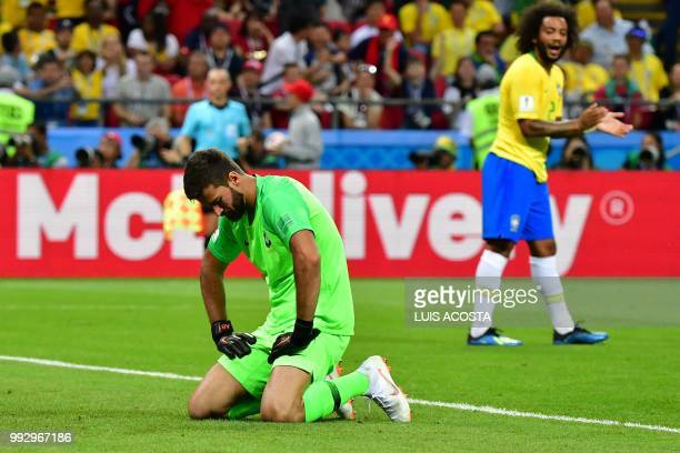 TOPSHOT Brazil's goalkeeper Alisson reacts after taking a second goal during the Russia 2018 World Cup quarterfinal football match between Brazil and...