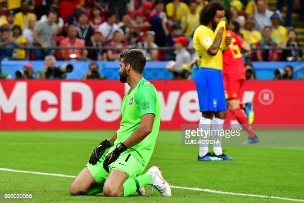 Brazil's goalkeeper Alisson reacts after taking a second goal during the Russia 2018 World Cup quarterfinal football match between Brazil and Belgium...