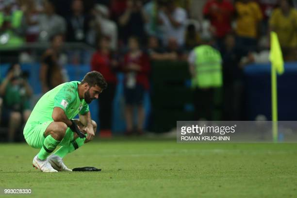 Brazil's goalkeeper Alisson reacts at the end of the Russia 2018 World Cup quarterfinal football match between Brazil and Belgium at the Kazan Arena...