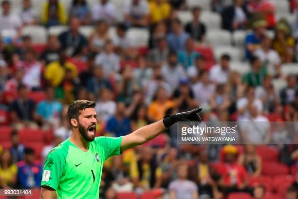 Brazil's goalkeeper Alisson speaks to his teammates during the Russia 2018 World Cup quarterfinal football match between Brazil and Belgium at the...