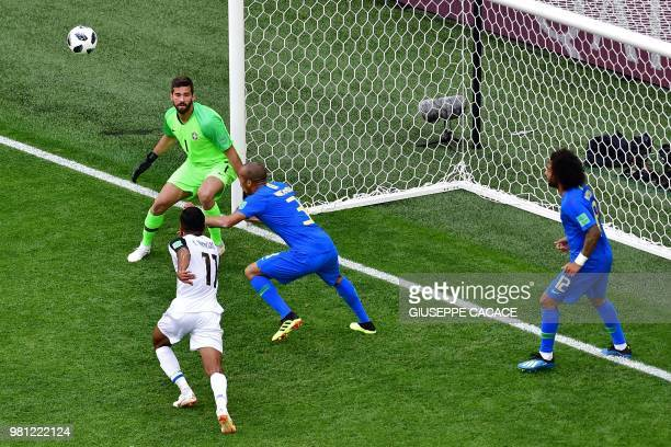 Brazil's goalkeeper Alisson stands in front of Brazil's defender Miranda and Costa Rica's forward Johan Venegas during the Russia 2018 World Cup...