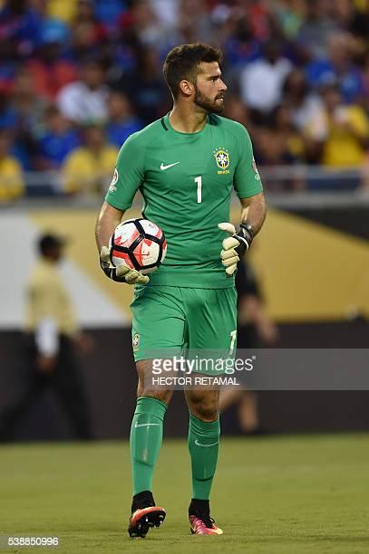 Brazil's goalkeeper Alisson takes part in a Copa America Centenario football match against Haiti in Orlando Florida United States on June 8 2016 /...