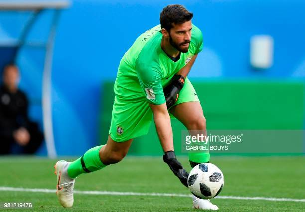Brazil's goalkeeper Alisson throws the ball during the Russia 2018 World Cup Group E football match between Brazil and Costa Rica at the Saint...