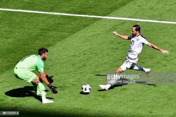 Brazil's goalkeeper Alisson vies with Costa Rica's forward Marco Urena during the Russia 2018 World Cup Group E football match between Brazil and...