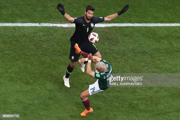 TOPSHOT Brazil's goalkeeper Alisson vies with Mexico's forward Javier Hernandez during the Russia 2018 World Cup round of 16 football match between...
