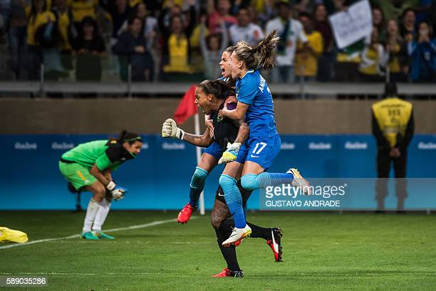 Brazil's goalkeeper Barbara and teammates Andressa and Rafaelle celebrate after the former stopped a penalty to defeat Australia in the penalty...